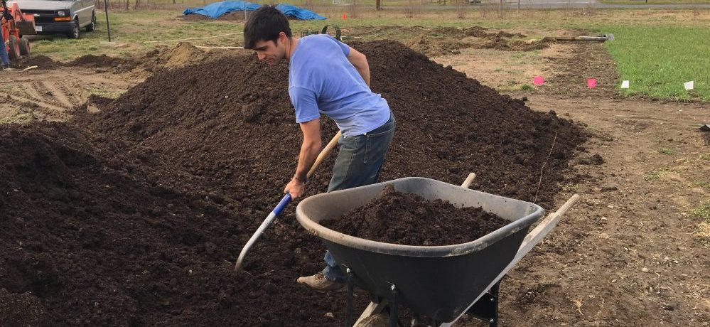 Diego Shoveling Compost In Giving Garden